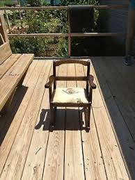 homemade brown child s rocking chair