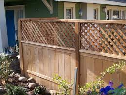 Add Lattice To Extend Height Of Privacy Fence Privacy Fence Backyard Fences Small Backyard Backyard