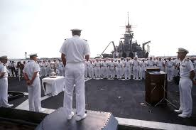 Admiral Wesley McDonald, Commander in CHIEF, United States Atlantic Fleet,  center, speaks during the presentation of the 1984 Batternberg Cup to the  battleship USS IOWA (BB 61). The ship received the award