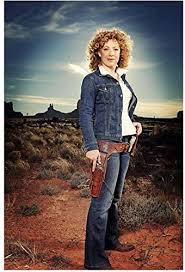 Alex Kingston as River Song in western setting hand on gun in ...