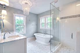 glass chandelier and pedestal tub