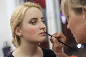 makeup artist doing makeup for a