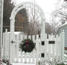 Spaced Sabre Scallop Wood Fence With Arbor Gate By Elyria Fence
