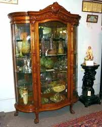 antique curved glass china cabinet