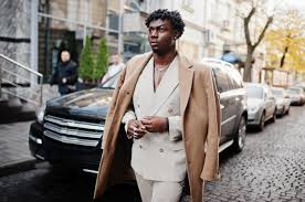 Premium Photo | Stylish afro man in beige old school suit and coat walking  against black business car. fashionable young african male in casual jacket  on bare torso.