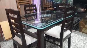 brown solid teakwood glass dining table