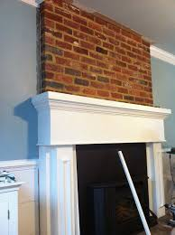 brick fireplace by crown molding