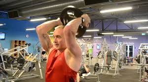 standing plate triceps extension you