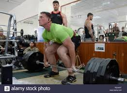 KABUL, Afghanistan - U.S. Army Staff Sgt. Aaron Reed, from Allentown, Pa.,  prepares to complete a dead lift in a strength competition judged by the  2015 Afghanistan Bodybuilding & Fitness Federation Champion