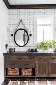 oval mirror over brown oak bath vanity