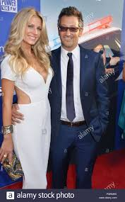 Luke greenfield - director and wife at the Let s Be Cops premiere at the  Arclight Theatre