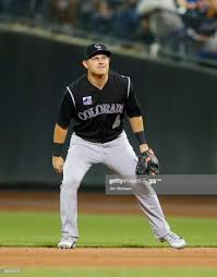 Pat Valaika of the Colorado Rockies in action against the New York ...