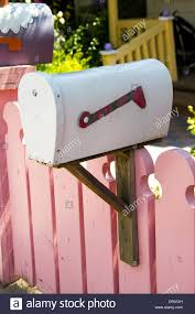 Pink Picket Fence With White Vintage Mailbox In Colourful Fairy Tale Stock Photo Alamy