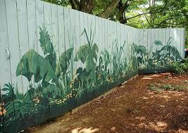 Fence Art 25 Pieces Of Art Using A Backyard Fence As The Canvas 100 Things 2 Do Garden Fence Art Garden Fence Paint Garden Mural