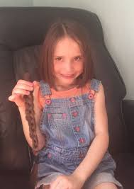 Daventry schoolgirl braves the chop for children with cancer | Daventry  Express