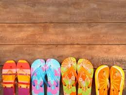 Brightly Colored Flip Flops On Wood Wall Mural Majestic Wall Art
