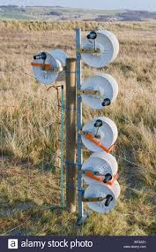 Reels Of Cable For An Electric Fence To Keep Cattle In A Field Stock Photo Alamy