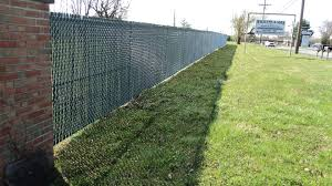 Galvanized Chain Link Fence With Green Pvc Privacy Slats Do You Have An Existing Chain Link Fence And Chain Link Fence Privacy Chain Link Fence Fence Styles