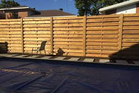 7 This Horizontal Sienna Treated Lumber Fence Is Elegant Yet Sturdy At 7 Feet High Montreal Proscape Patio Decks Montreal 514 421 9687