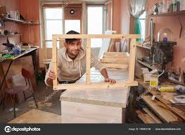 young man wooden window frames standing