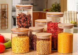 large glass storage jars with wood lid