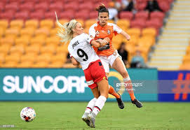 Carson Pickett of the Roar and Adriana Jones of Adelaide United ...