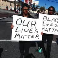 Slideshow: LA's Kwanzaa celebration draws attention to recent police  shootings | 89.3 KPCC