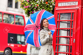 London Tourist Travel Woman With UK Flag Umbrella, Telephone.. Stock Photo,  Picture And Royalty Free Image. Image 108085390.