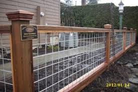 Deck Masters Nw Fencing Hog Panel Fence Also Called Bull Panel Or Wire Rod Panel Fencing Stacked Rock A Hog Panel Fencing Front Yard Fence Wire Fence Panels