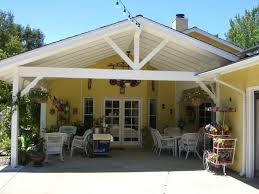 covered patio exposed beams gable roof