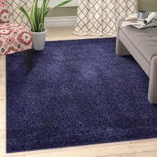 ebern designs zuniga navy blue area rug