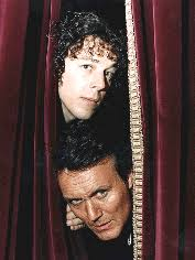 A publicity shot - Jonathan and Adam Klaus (The original one - Anthony  Stewart Head) poking their heads through a cu… | Jonathan creek, Klaus the  originals, People