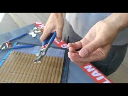 cutting small pieces of glass mosaic