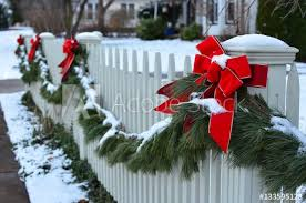 Snow Covered Evergreen Garland Draped Along A White Picket Fence Buy This Stock Photo And Explore Similar Images At Adobe Stock Adobe Stock