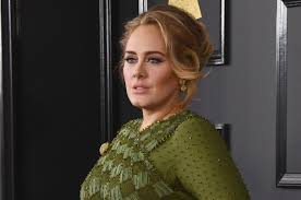 Fans accuse Adele of cultural appropriation after Jamaican flag bikini and  Bantu knots pic | Channel