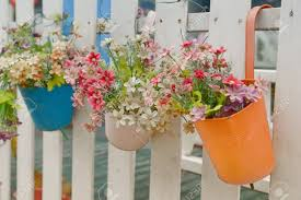 Hanging Flower Pots With Fence Stock Photo Picture And Royalty Free Image Image 26458502