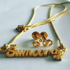 sumeera gold name pendant with earrings