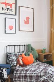 Kids Room With Toys And Checkered Bedsheets Laying On The Single Stock Photo Picture And Royalty Free Image Image 126997173