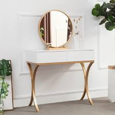 white wood makeup table with round