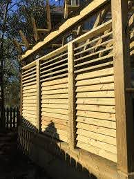 Exterior View Of A Louvered Fence Project The Hardware System Flexfence Is Hidden Seamlessly But Creates An Effective Redwood Decking Patio Deck Pergola Patio