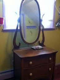 antique oak dresser with oval mirror