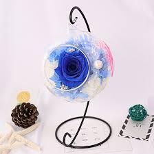 preserved rose flower in glass ball