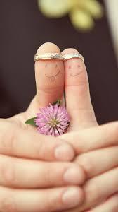 sweet fun wedding couple rings fingers