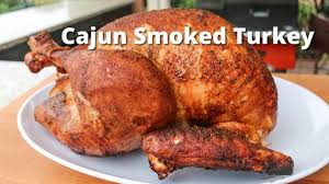 cajun smoked turkey on the grill with