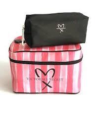 pink striped logo makeup bag train case