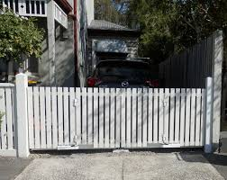 Bi Fold Trackless Automatic Gates Timber Picket Style Perfect For This Drive With No Room For A Standard Swing Picket Gate Driveway Gate Wood Gates Driveway