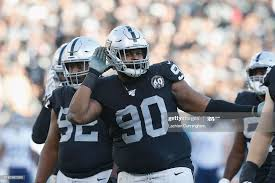 Johnathan Hankins of the Oakland Raiders pumps up the crowd in the ...