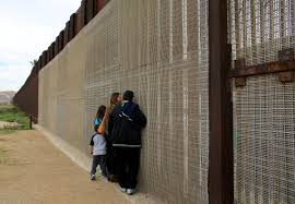 Print Families Separated By The Two Countries Chat Along The U S Mexico Border Fence At Border Field State Park California Religion News Service