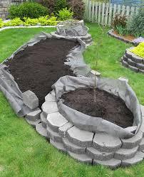 island bed with retaining wall bricks