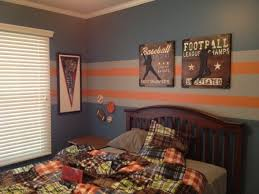 Pin By Lacey Bush On Boy Bedrooms Boy Sports Bedroom Sports Themed Bedroom Sports Themed Room